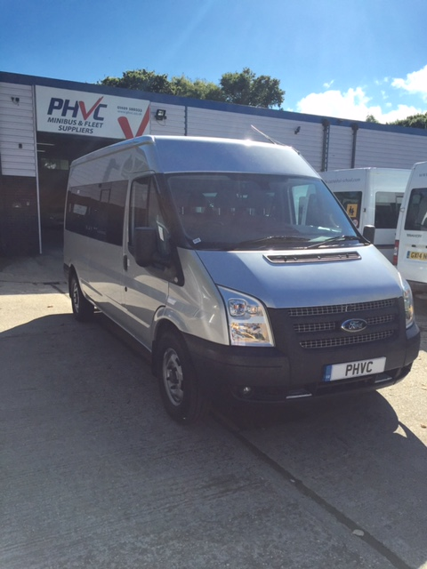 Photograph of Ford Transit 14 Seat Minibus – Silver